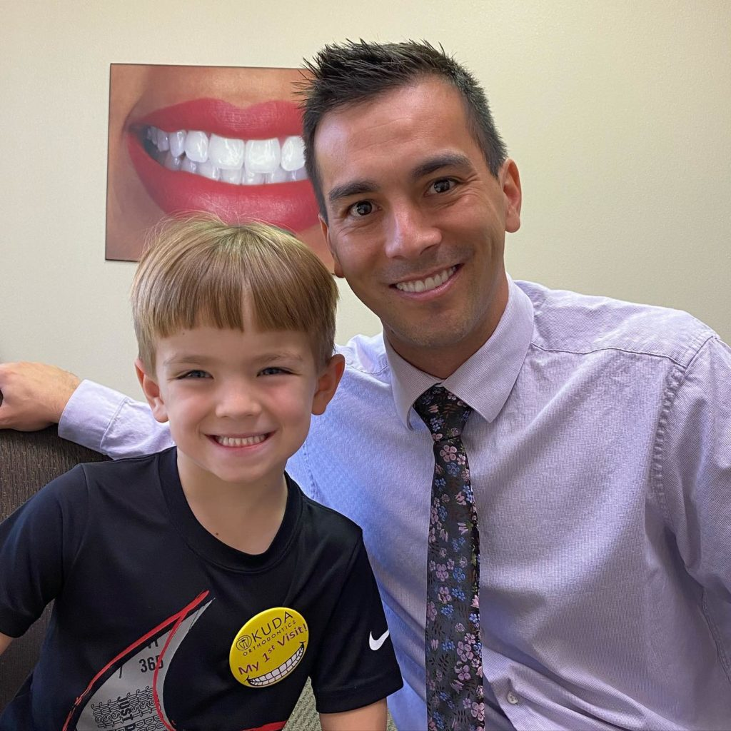 dr Okuda with a young patient smiling
